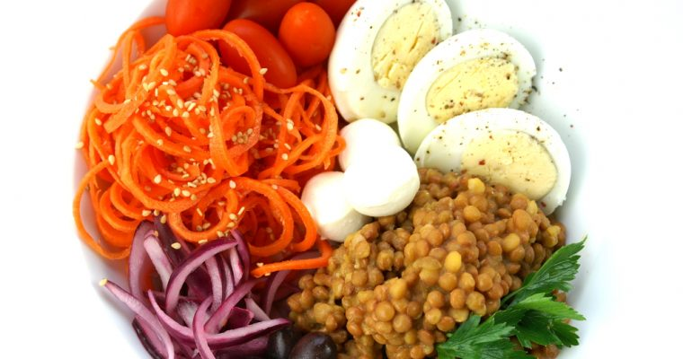 Healthy plate of lentils, vegetables and egg